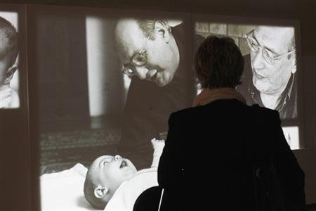 A woman observes a multimedia artwork at Mark Rothko Art Center in Daugavpils