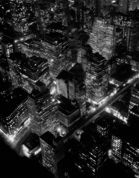 A nighttime view of New York City, USA, 1932. (Photo by Berenice Abbott/Getty Images)